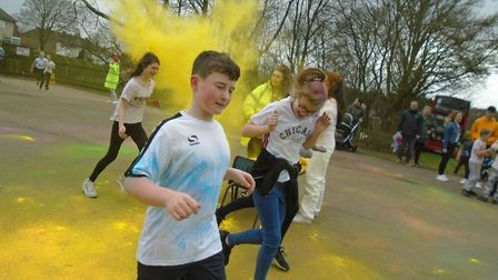 Children and adults alike enjoyed a Colour Run while raising funds for Camps Hill Primary School and