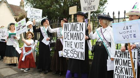 The Suffragettes chain themselves to the railings.Picture: Karyn Haddon