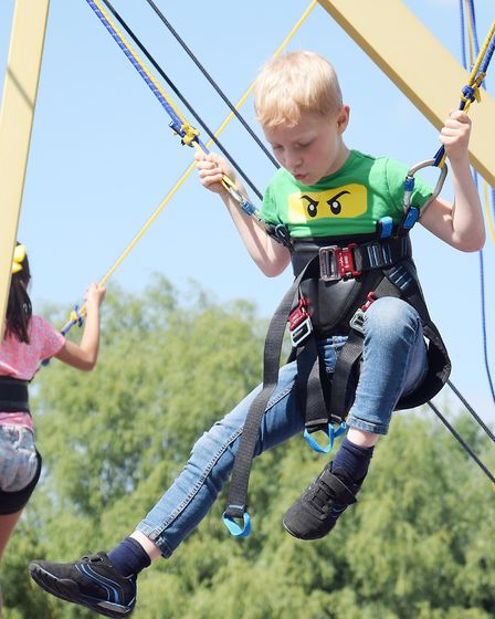Walsworth Festival 2018: A child on the bungee jumping. Picture: Alan Millard