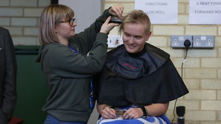 Hitchin Girl's School year 11 pupil Rebecca Turner has her head shaved in front of her school to rai