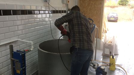 Richard Haigh hard at work cleaning the brewery. Picture: Dan Mountney