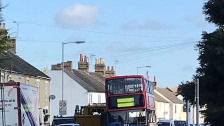 Buses, lorries and cars frequently use the pavement to get through tight gaps in Arlesey High Street