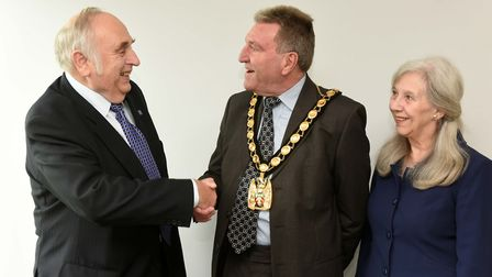 North Herts District Council chairman John Bishop is congratulated by his predecessor Alan Millard a