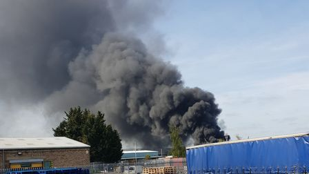 The black plume of smoke in Hitchin's industrial area. Picture: James Payne