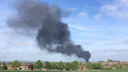 A fire is burning in Hitchin as black smoke rises over the town. Picture: Pippa Akram