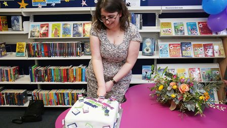 Hitchin Library manager Rebekah Nicolas cuts her cake at the official reopening of Hitchin Library.
