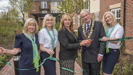 The Mayor of Biggleswade, Cllr Michael North, cuts the ribbon to officially open the new McCarthy an
