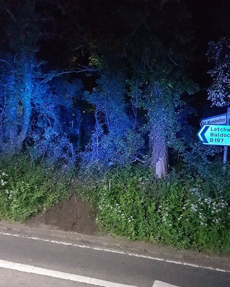 A car disappeared into woodland after crashing in Graveley High Street. Picture: @HitchinFire1 via T