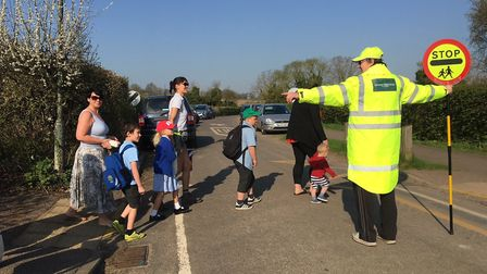 St Paul's Walden lollipop man Andrew Dilley at his post with his new uniform. Picture: Country Prope