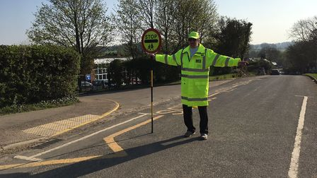 St Paul's Walden lollipop man Andrew Dilley at his post. Picture: Country Properties