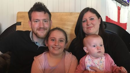 Dan Prowse and Charlotte Sellis with baby Eden and her nine-year-old sister Paige. Picture: JP Asher