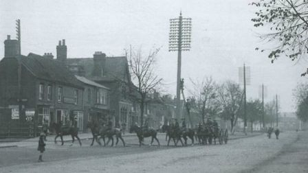 Horses, wagons and men of the New Zealand Reserve Signal Company in Stevenage Old Town High Street,