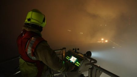 Firefighters on the scene at Bedfordshire Growers near Biggleswade during the fire last night. Pictu