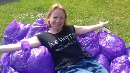 Hitchin Slimming World consultant Marie Gill with the bags of donated clothes. Picture: Marie Gill