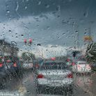 A car stuck at red traffic lights in the rain. Picture: jes2ufoto.