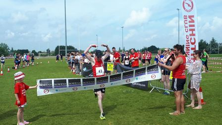 Crossing the finish line at the Hitchin Relay Race. Picture: Jake Amos