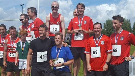 The men's podium after the Hitchin Relay Race, with captain Chris Fry heading up overall winners The
