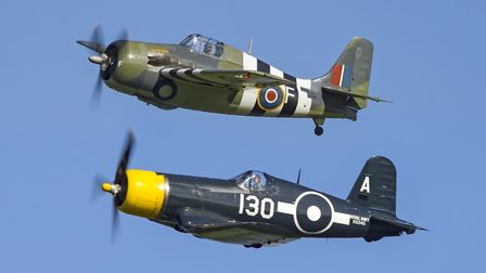 The Vought Corsair and Grumman Wildcat of Duxford's Fighter Collection roar over Old Warden. Picture