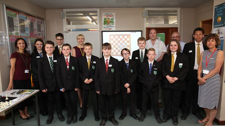 Fearnhill staff and pupils with International Chess Master Paul Littlewood who played a Chess Simul