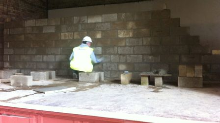 March 2014: Contractors for North Herts District Council build a wall across the Hitchin Town Hall s