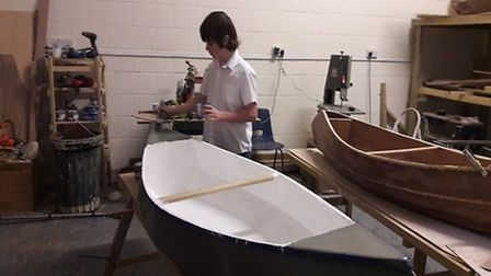 The boys created canoes from scratch. Picture: Brandles School