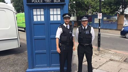Alex Marshall (right) with his son Angus, who has followed his dad's lead in becoming a police offic