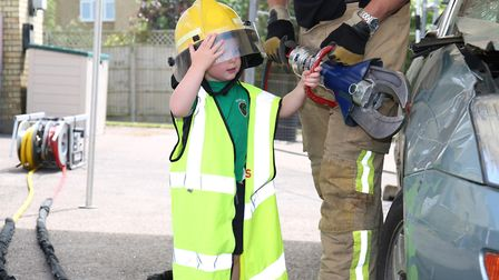 Finley Goodliffe, three, has a go with the cutting equipment at Hitchin Fire Station Open Day. Pictu