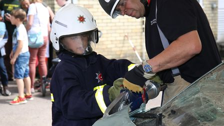 Thomas Pope, eight, has a go with the cutting equipment at Hitchin Fire Station Open Day. Picture: C