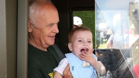 Joel Baines, two, sits in his grandad David Tinney's lap in an ambulance at Hitchin Fire Station Ope