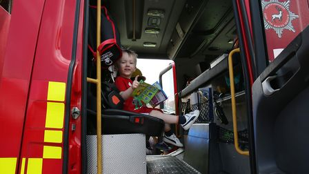 Billy Wells, two, sits in a fire engine at Hitchin Fire Station Open Day. Picture: CALLUM ALLCOCK-GR