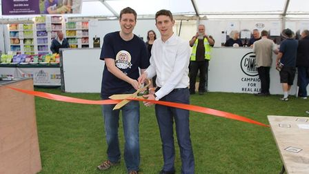 Hitchin town centre manager Tom Hardy (right) officially opens the best festival. CREDIT: HBF
