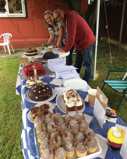 Cookery Eatery's Emma Ince Goulding and Triangle Community Garden's John Wyer judging the junior bak