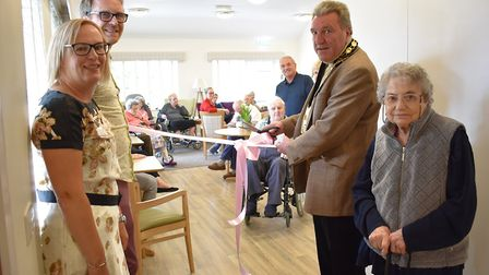NHDC chairman John Bishop prepares to cut the ribbon at Providence Court's newly refurbished café in