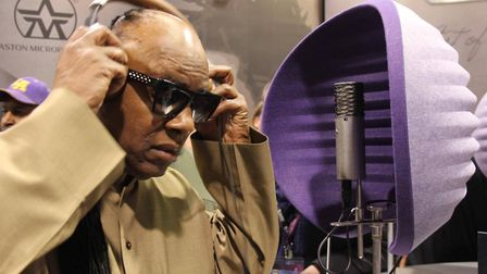 Stevie Wonder using Hitchin-based Aston Microphones' Spirit mic and Halo portable recording booth. P