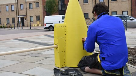 David Appleyard of the FAR project with the Tornado fuel tank that has been screwed into the street.