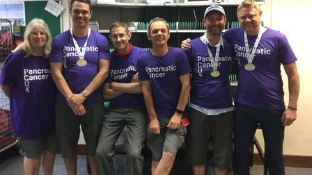 Staff from the Sandy postal delivery office have raised £1,000 for Pancreatic Cancer UK. (left to ri