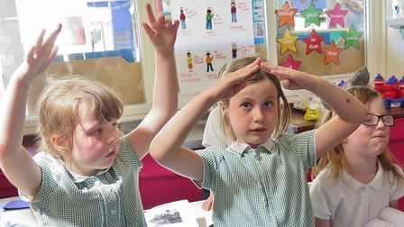 Year 2 children (left to right) Florence, Lauren and Michaela add actions to words from John Masefie