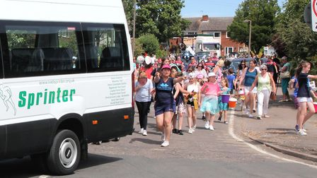 Crowds follow the Ivel Sprinter bus at the 2018 Biggleswade Carnival parade. Picture: Andy Buckley