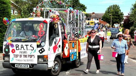 Biggleswade Amateur Theatrical Society with their Top of the Pops-themed float at the Biggleswade Ca