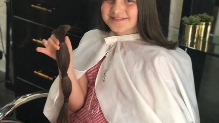 Amie Woods, nine, has donated her hair to the Little Princess Trust. Picture: Naomi Woods