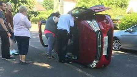 The car on its side after the crash in West View, Letchworth. Picture: Kelly Butt Banner