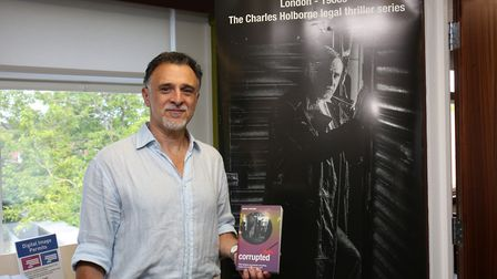 Hertfordshire authors member Simon Michael speaks about his new book at Hitchin Library. Picture: DA
