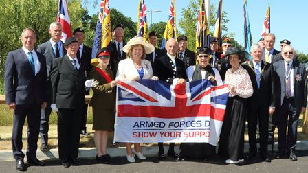 Bedfordshire Lord-Lieutenant Helen Nellis and other dignitaries with the Armed Forces Day flag at th