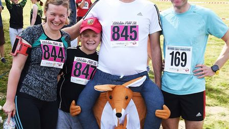 Paul Watson in his kangaroo-rider costume, with his family and friends. Picture: Alan Millard