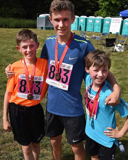 Hitchin Hard Half 5k winner Callum Turner, centre, second-placed Ollie Holmes, left and third-placed