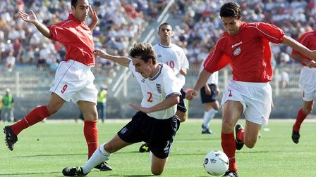 England's Gary Neville is tackled in the Maltese penalty box, during their international friendly fo