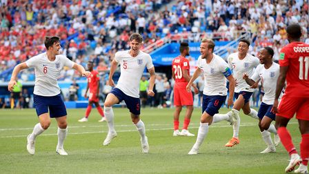 England's John Stones (second left) celebrates scoring his side's fourth goal of the game during the