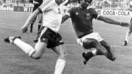 France's Gerard Janvion (right) goes in to tackle Poland's Zbiginew Boniek during the third place ma