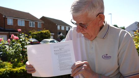 Peter Sutherst holding a copy of the Scout Association's Royal Charter, which is part of Gerry Pope'