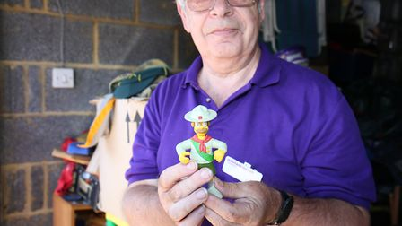 Gerry Pope with some of his collection of scouting memorabilia. Picture: DANNY LOO